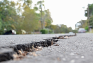 City inspectors are investigating why a new road surface that was designed to last 20 years is cracking and sinking in several places in Burleson Heights.